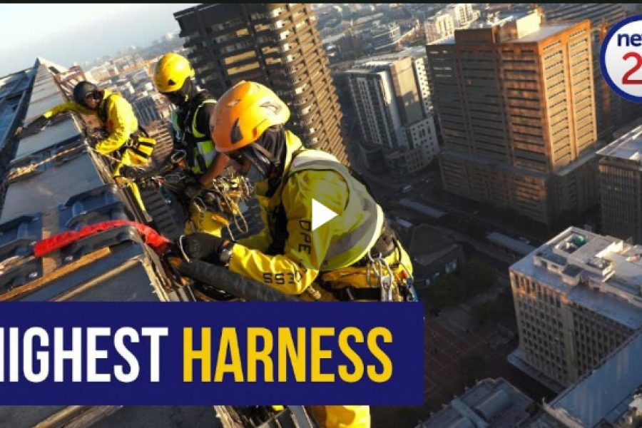 Over The Edge With A High Rise Window Washer